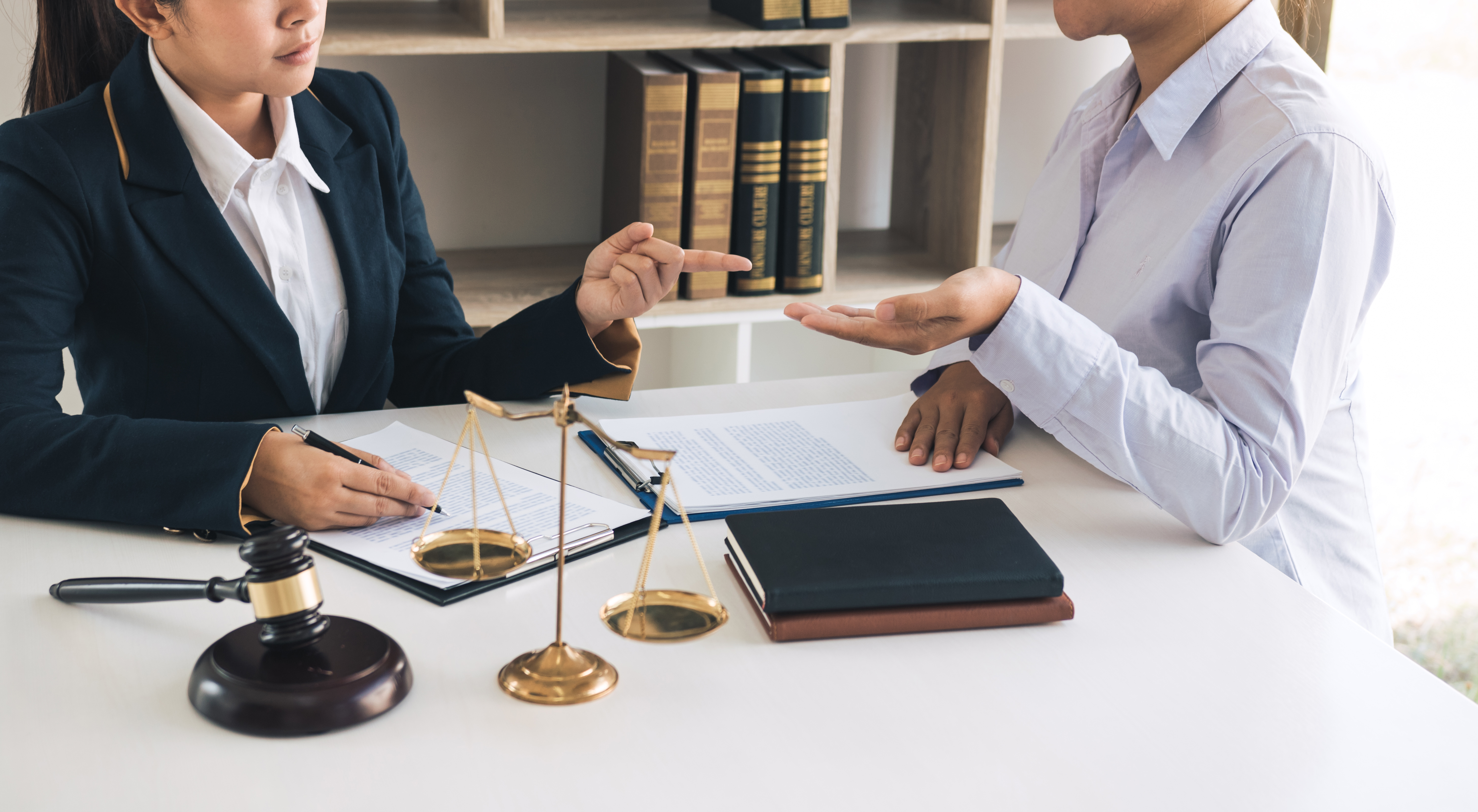 legal-advisor-is-explaining-the-offense-under-the--Y5DQ2B7